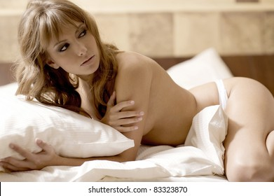 beautiful blonde woman in bed