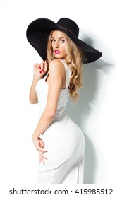 beautiful-blonde-woman-black-hat-260nw-415985512.jpg