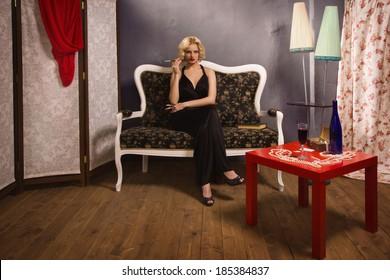 Beautiful blonde woman in boudoir. Retro style