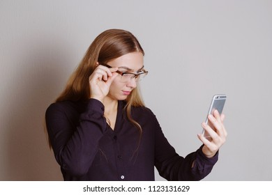 Beautiful blonde woman concentrated on the phone