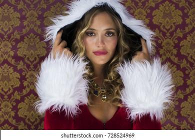beautiful blonde woman dances in cute santa claus costume for christmas time disco shoot