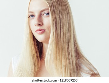 Beautiful blonde woman face with healthy long blond hair natural makeup young girl