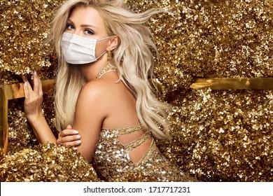 Beautiful blonde woman in face mask in golden flowers garden