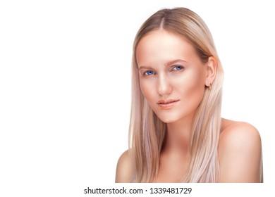 Beautiful blonde woman face studio on white. high key portrait