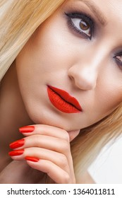 Beautiful blonde woman face studio on white.evening makeup, red lipstick. high key portrait