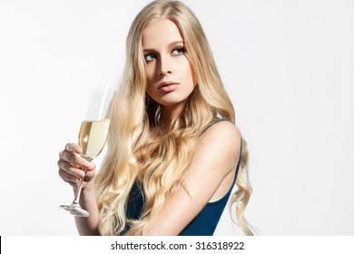 Beautiful blonde woman with a glass of champagne in his hand isolated on white background