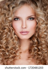 Beautiful blonde woman. Healthy Long Blond Hair. Curly Hair. Blond. Permed Hair. Afro curls. Beauty Model Girl with Luxurious Hair.