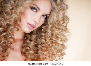 Beautiful blonde woman. Healthy Long Blond Hair. Curly Hair.   Blond, permed Hair