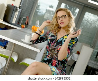 a beautiful blonde woman in her kitchen