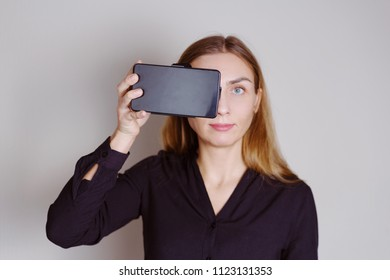 Beautiful blonde woman holding vr spectaculars
