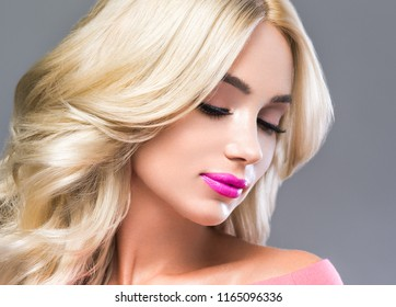 Beautiful blonde woman hot pink color lipstick beautiful hairstyle female model