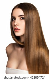 Beautiful blonde woman with long, healthy, straight and shiny hair. Hairstyle loose hair. Model girl with luxurious smooth straight hair. Hair cosmetics. White background.