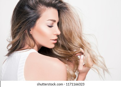 beautiful blonde woman with long shiny hair and bright makeup. Lifestyle and cosmetics concept. studio shot, horizontal.