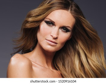 Beautiful blonde woman longhair beauty fashion makeup close up portrait
