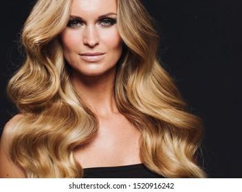 Beautiful blonde woman longhair beauty fashion makeup close up portrait