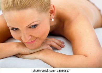 Beautiful blonde woman lying on a stretcher