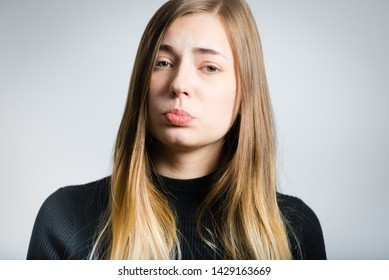 beautiful blonde woman offended isolated on background