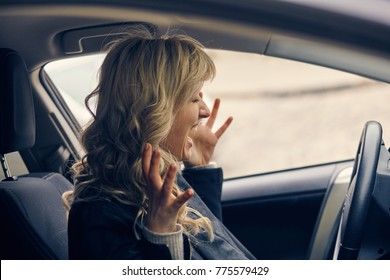 Beautiful blonde woman panic in the car. emergency, accident, road, hazard concept