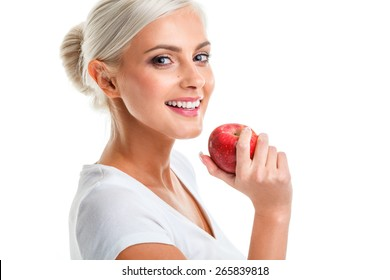 beautiful blonde woman with red apple in hand over white