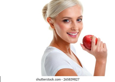 beautiful blonde woman with red apple in hand