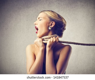 beautiful blonde woman screaming with fear