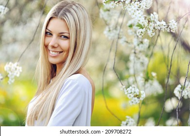 Beautiful blonde woman in spring
