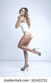 Beautiful blonde woman in swimsuit posing