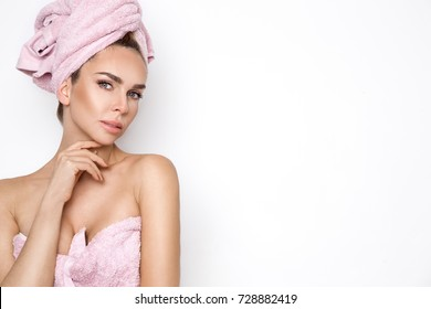 Beautiful blonde woman with a towel on her head
