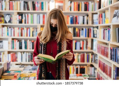 Beautiful blonde woman wearing a face mask with a book in a bookstore.