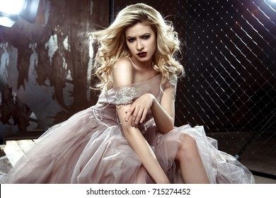Beautiful blonde young bride woman in color wedding dress. rock style, fashion beauty photo