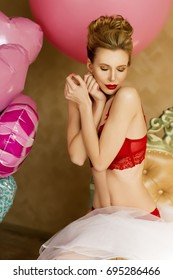the beautiful blondel girl model in red lingerie