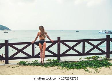 Beautiful blondy woman on a beach