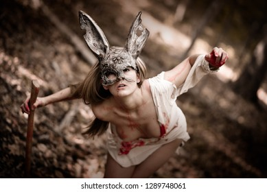 Beautiful bloody woman wearing a rabbit mask