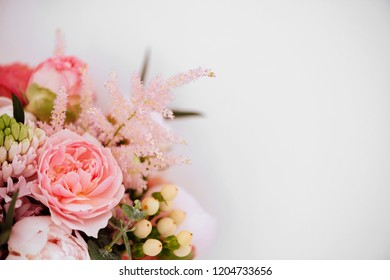 Beautiful blossoming flowers: peonies, roses, ranunculus, tulips, carnations,eustoma lisianthks hydrangea in tender pink colour