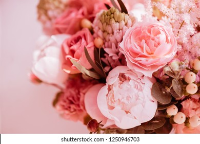 Beautiful blossoming flowers: peonies, roses, ranunculus, tulips, carnations,eustoma lisianthks hydrangea in tender living coral colour
