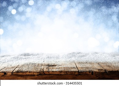 Photo of beautiful blue blurred background of winter and shabby table