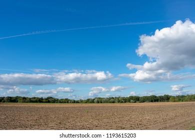 beautiful blue cloud sky over mowed field. Location: Germany, North Rhine - Westphalia, Borken