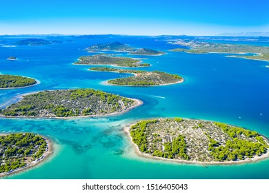 Beautiful blue coast in Croatia, small Mediterranean stone islands in Murter archipelago coastline, aerial view of turquoise bays from drone