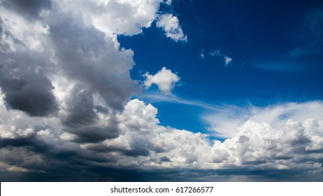 beautiful blue and dark sky cloud background. Clouds break up.  Interesting bright sky. Panoramic composition in high resolution.