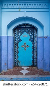Beautiful blue door in Chefchaouen, Morocco. Chefchaouen is the chief town of the province of the same name, and is noted for its buildings in shades of blue.