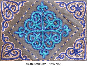 Beautiful blue embroidery in Kazakh style. Closeup. Selective focus