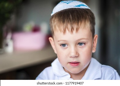 A beautiful blue eyed Caucasian kid with a traditional Jewish kippah cap on his head. A Russian-speaking Jew in Israel portrait. Post-Soviet Jews make up over 15 per cent of Israeli society.