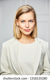 Beautiful blue eyed woman in smart business attire