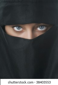 Beautiful blue eyed woman in traditional Niqab veil