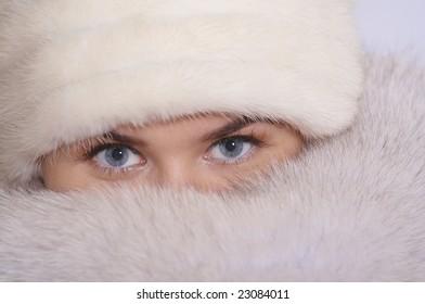 Beautiful blue eyes of a winter woman