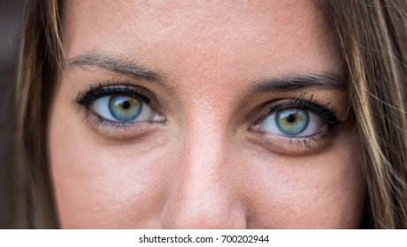 Beautiful blue eyes of young woman. Close up.