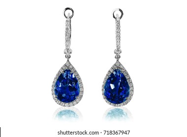 Beautiful blue fashion fine jewelry earrings. Drop style with diamond halo accents. Pear shaped and elegant sapphire gemstones.