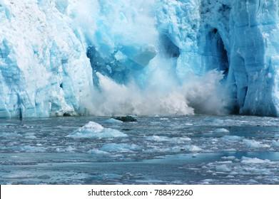 Beautiful blue glacier calving