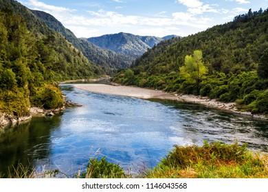 Beautiful blue green river flowing on summer time in New Zealand South Island