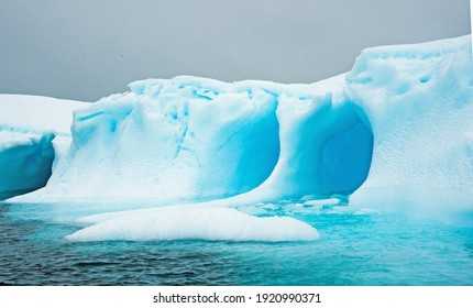 Beautiful blue ice berg with carved ice in Antarctica